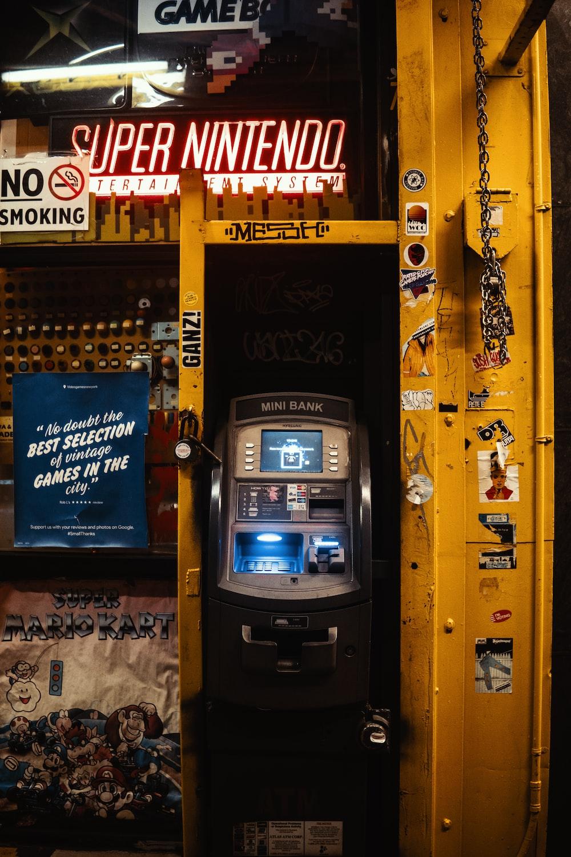 gray and black mini bank ATM machine toy