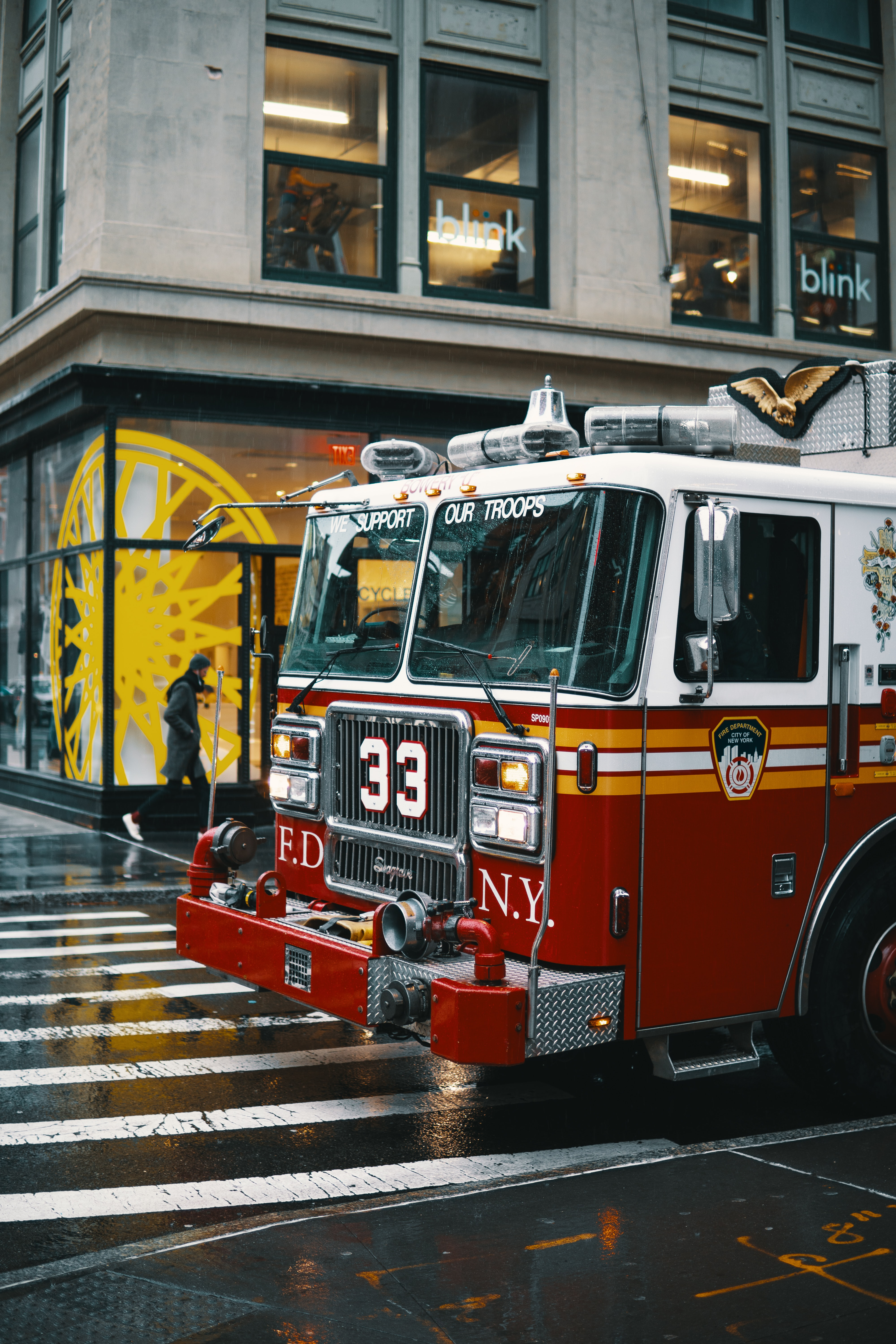 shallow focus photo of white and red firetruck