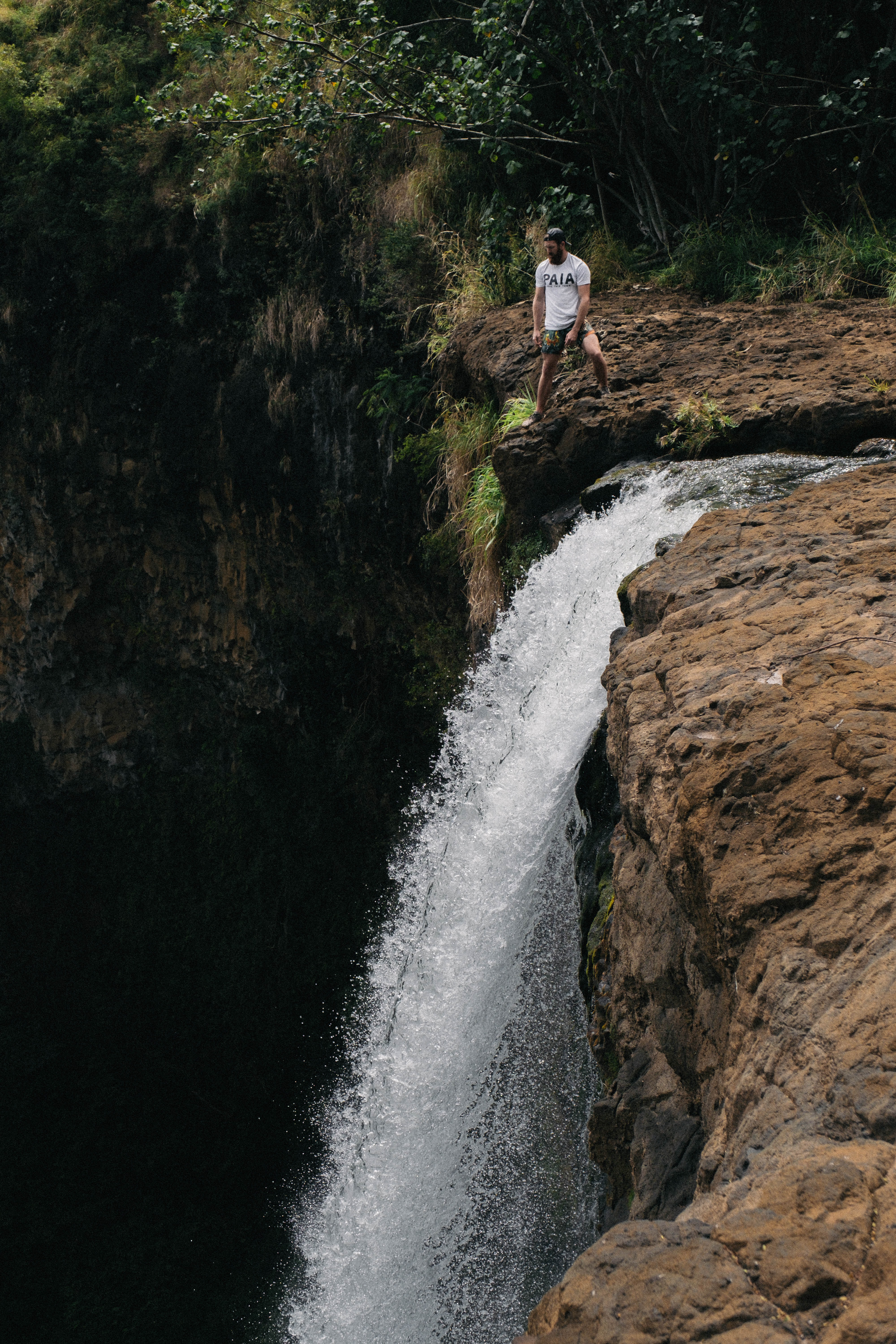 person standing atop waterfall
