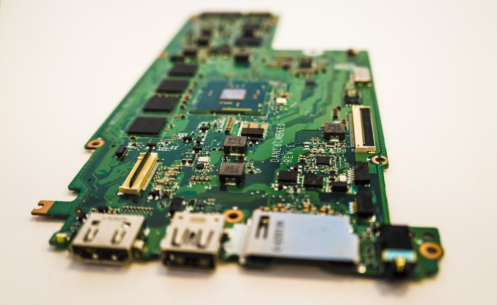 green circuit board on white table