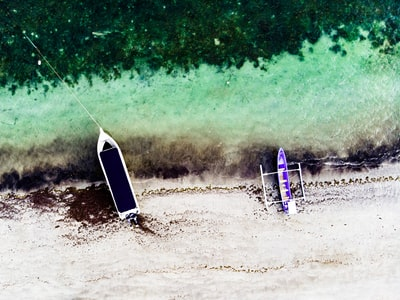 aerial photography of two boats on seashore timor-leste teams background