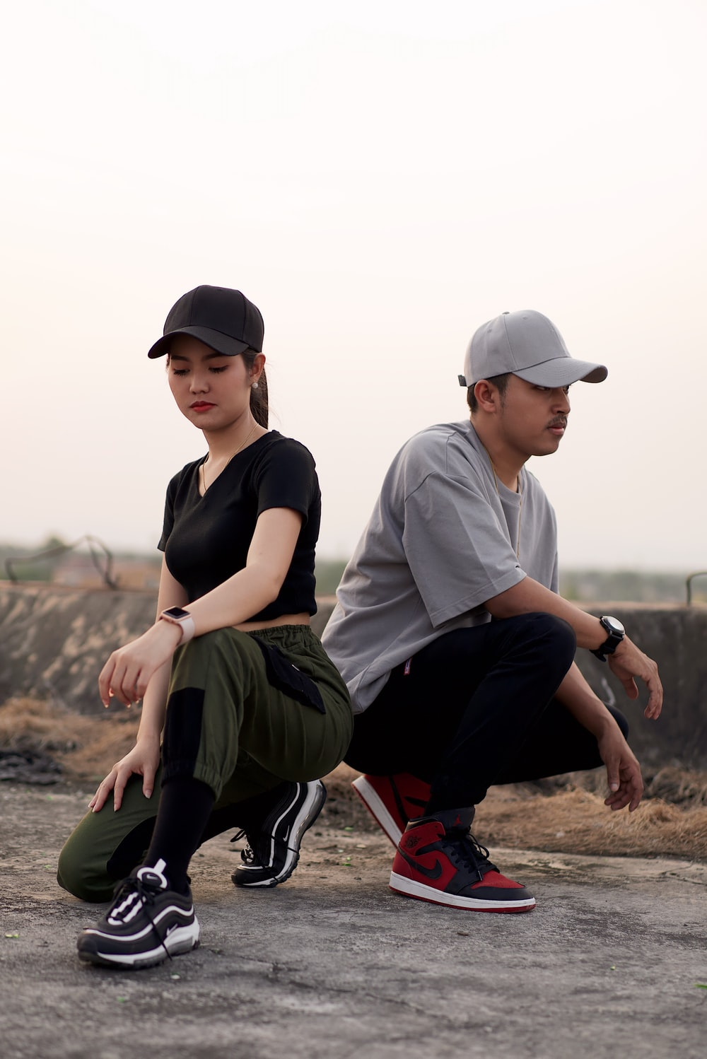 two man and woman wearing fitted caps