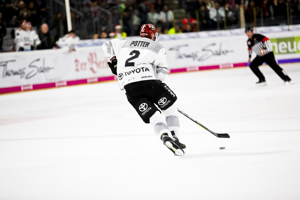 man playing ice hockey on the field