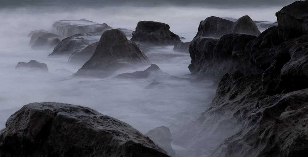 stone formations during foggy daytime