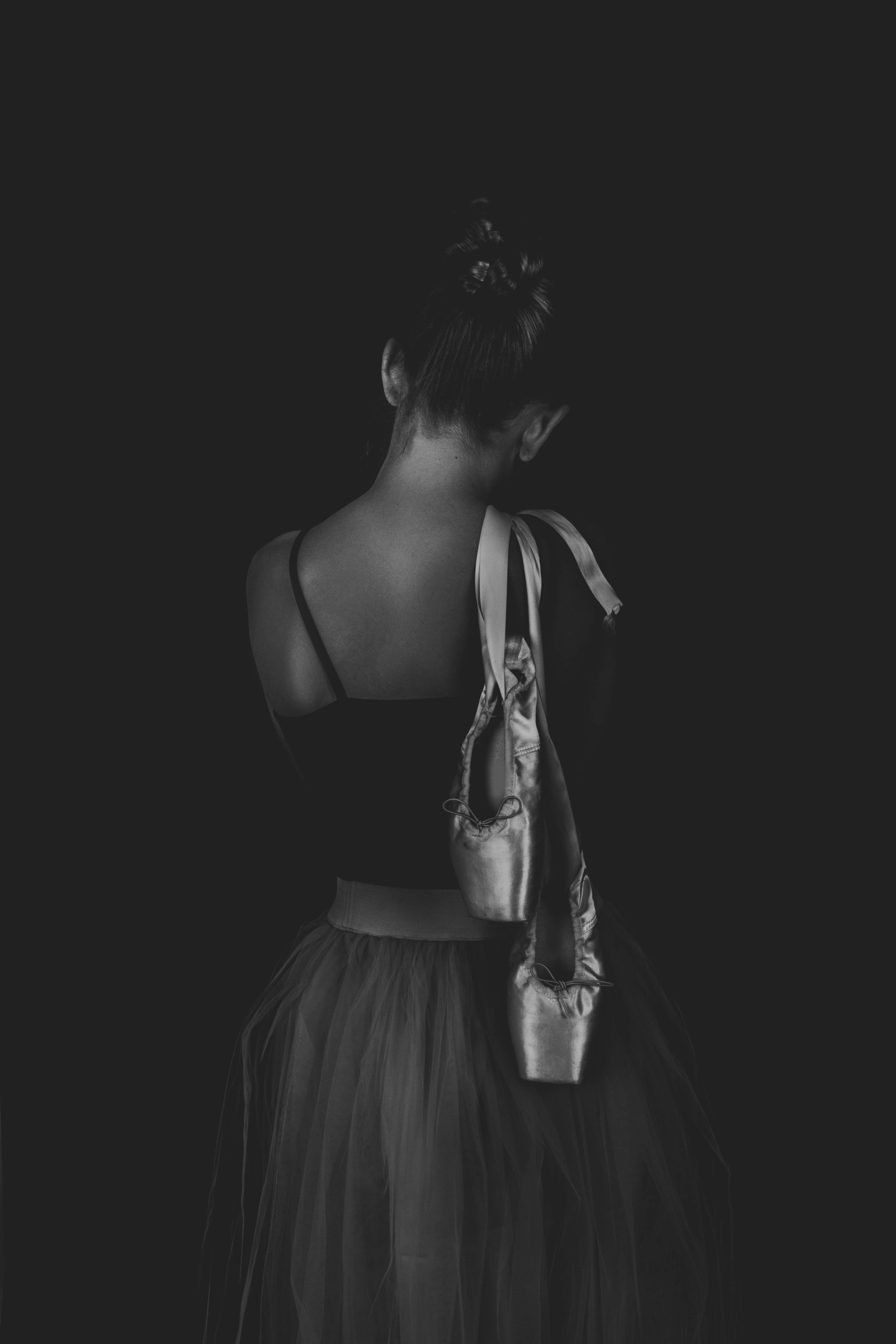 grayscale photo of woman wearing crop top
