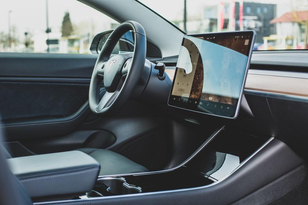 turned-on monitor inside vehicle