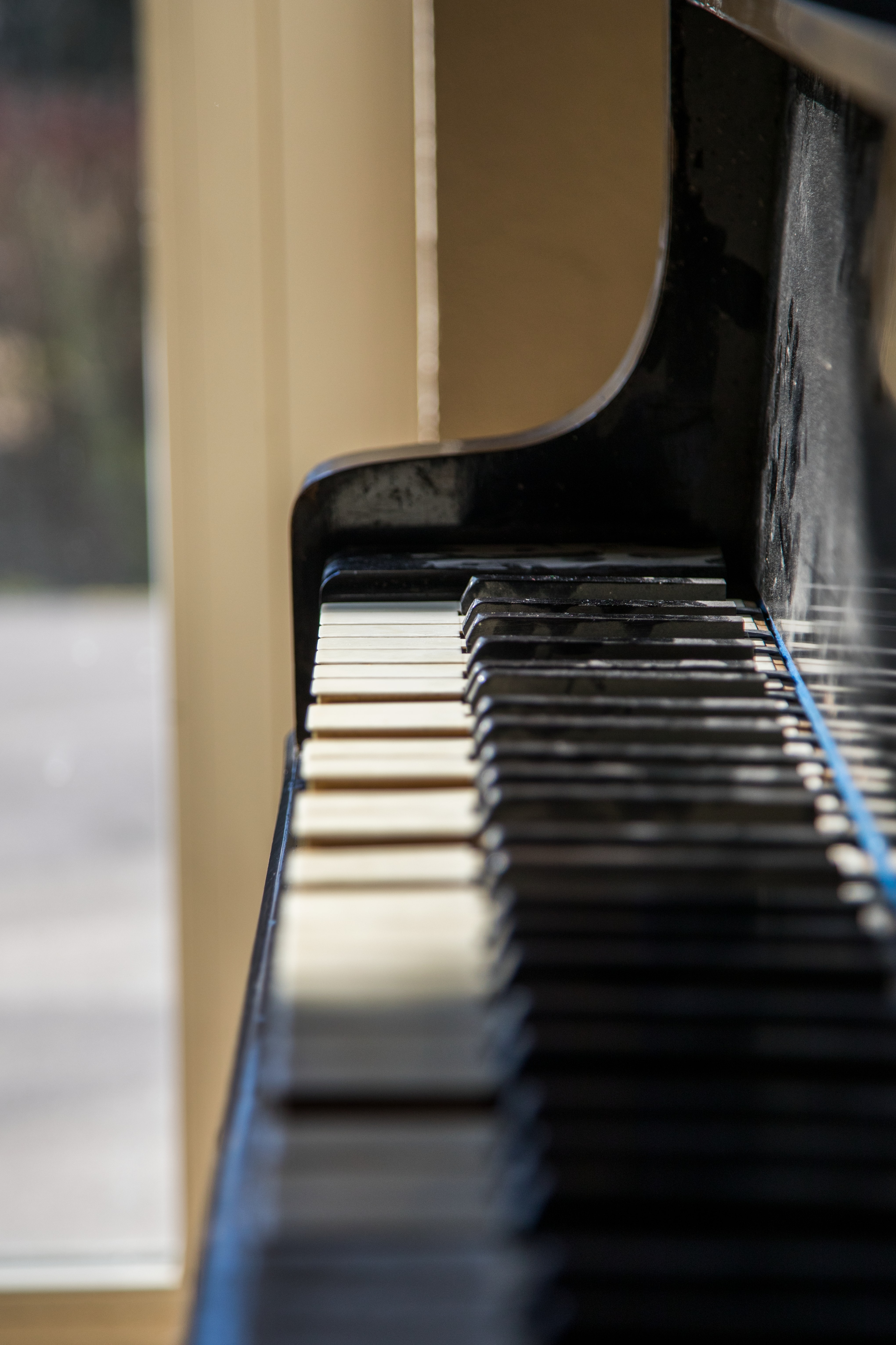 selective focus photography of black piano