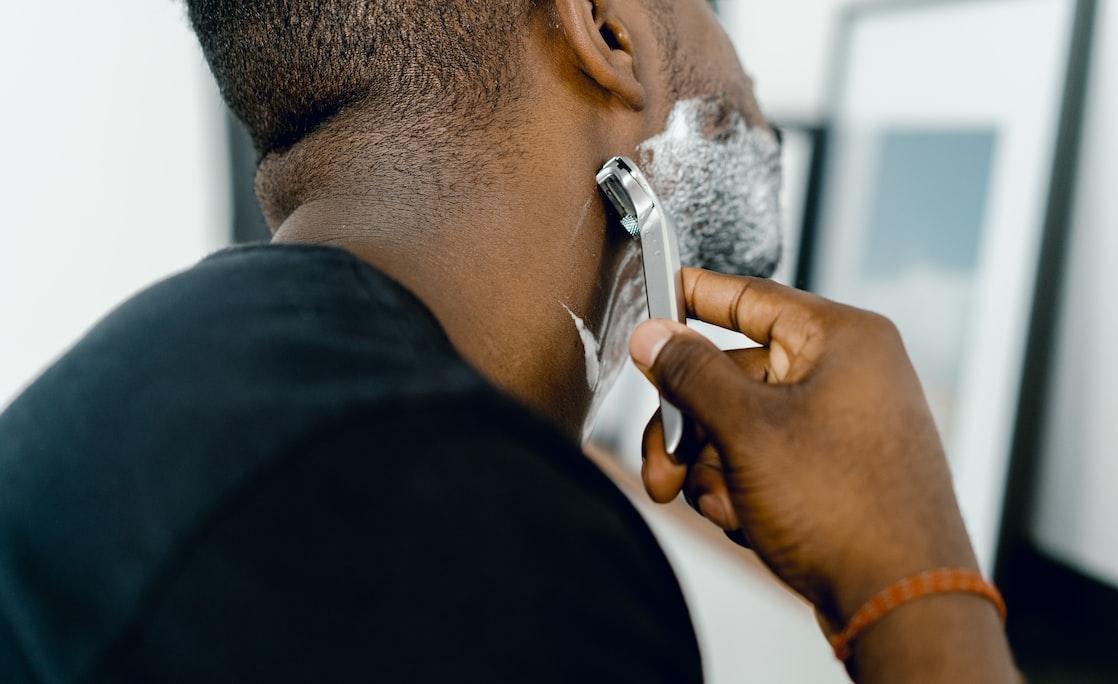 a man trimming his beard