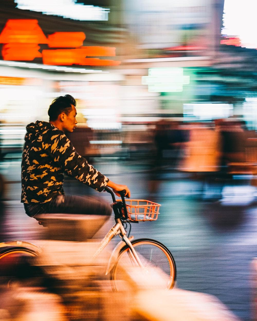 man riding on bike during daytime