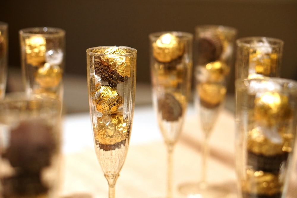 chocolate candies on champagne flutes