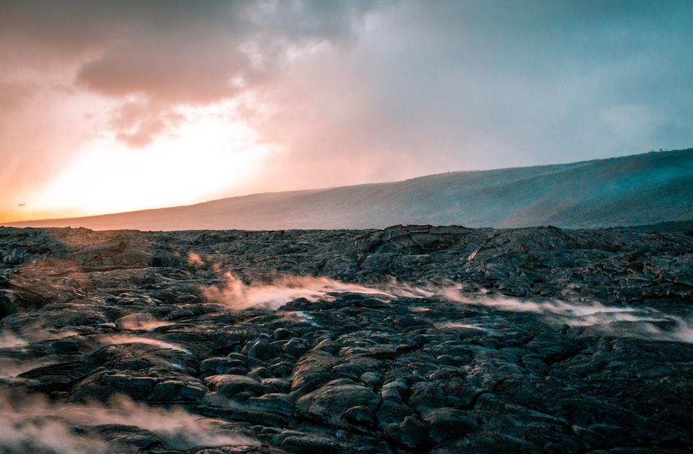 rock valley under grey clouds