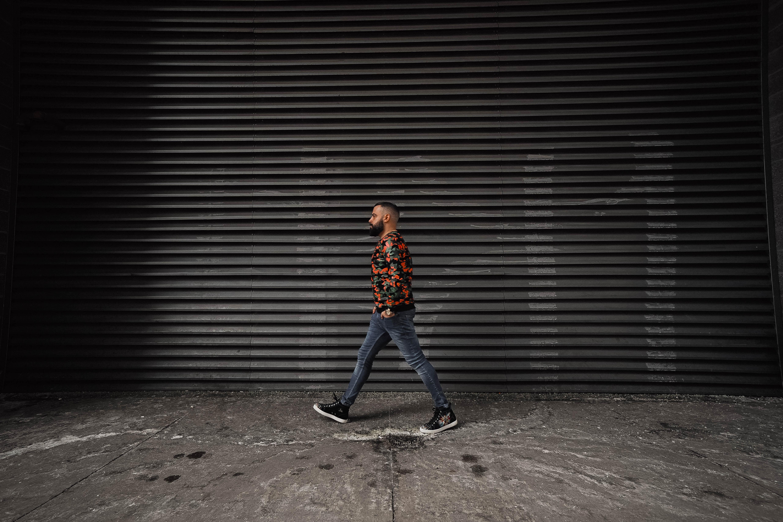 man walking near wall
