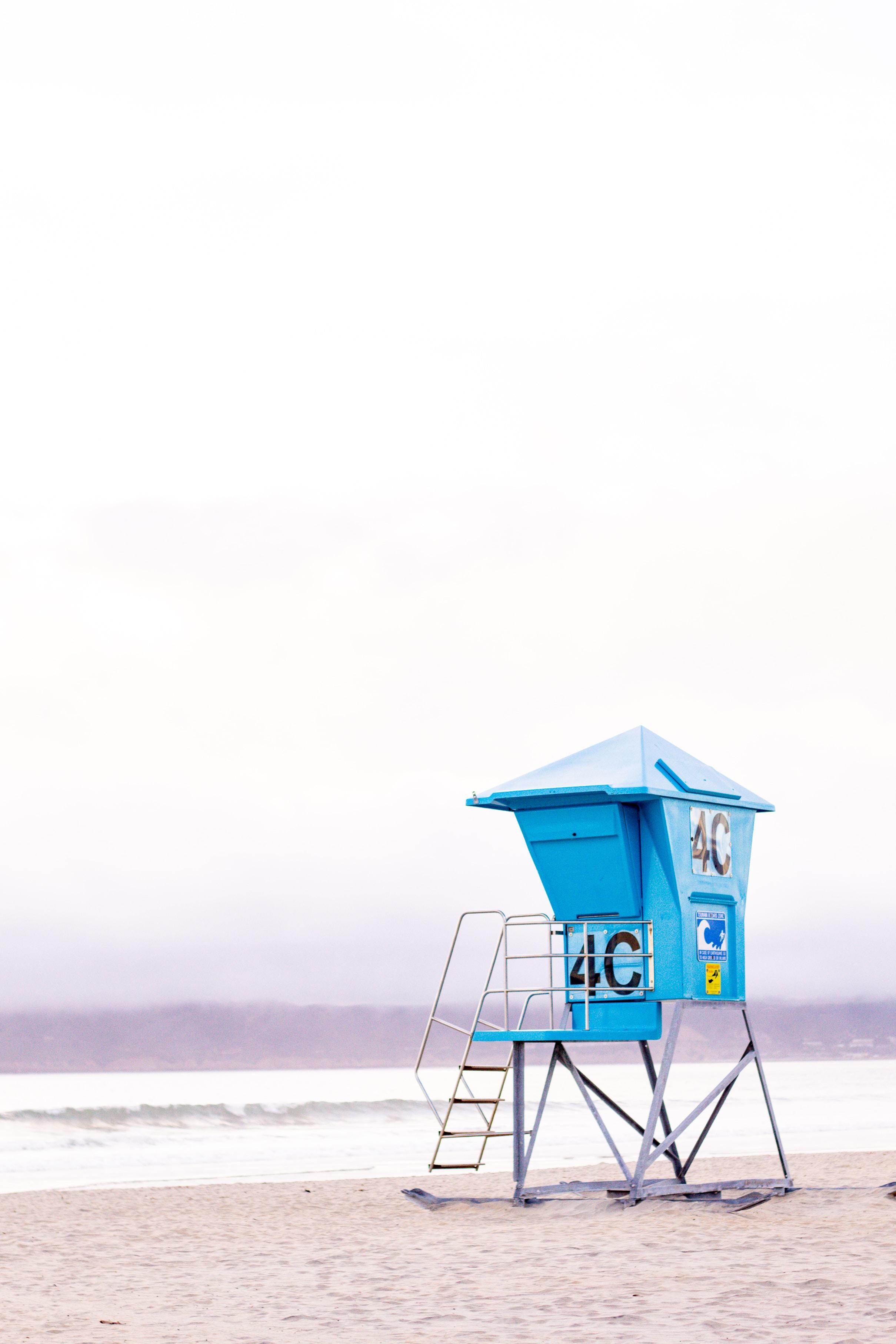 blue lifeguard house near seashore