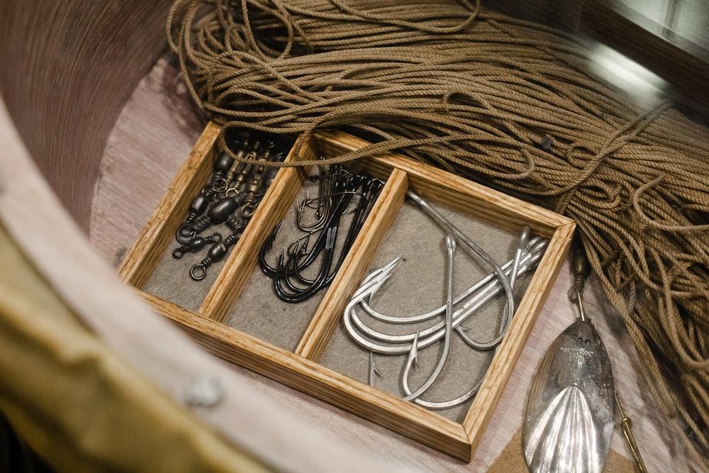 hooks on brown wooden board