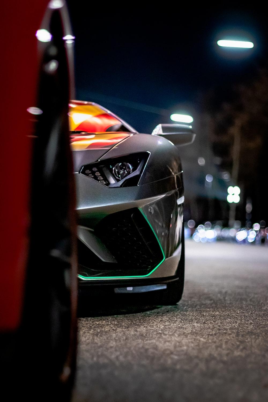 gray vehicle on road at night