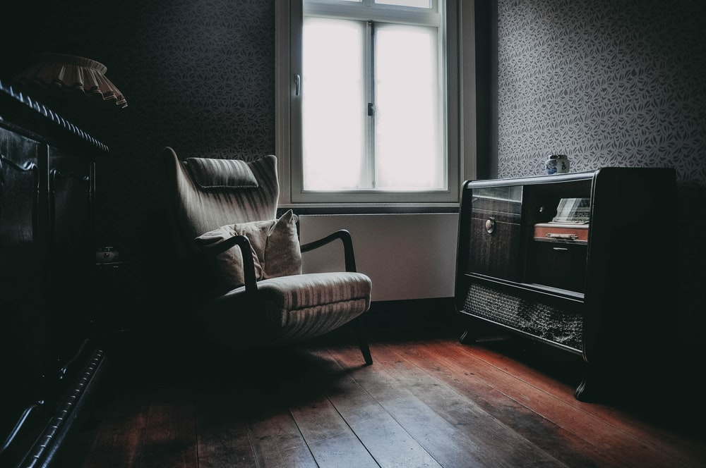 padded armchair inside room