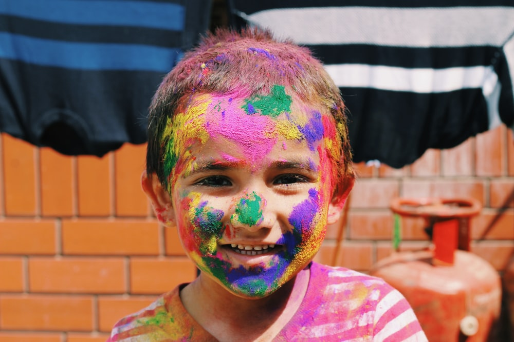 boy smiling with face paint