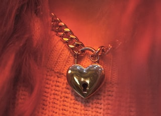 silver-colored heart pendant necklace