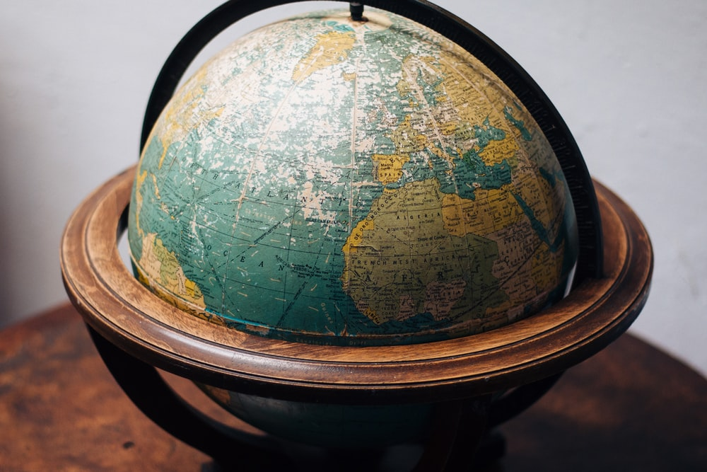 selective focus photography of terrestrial globe