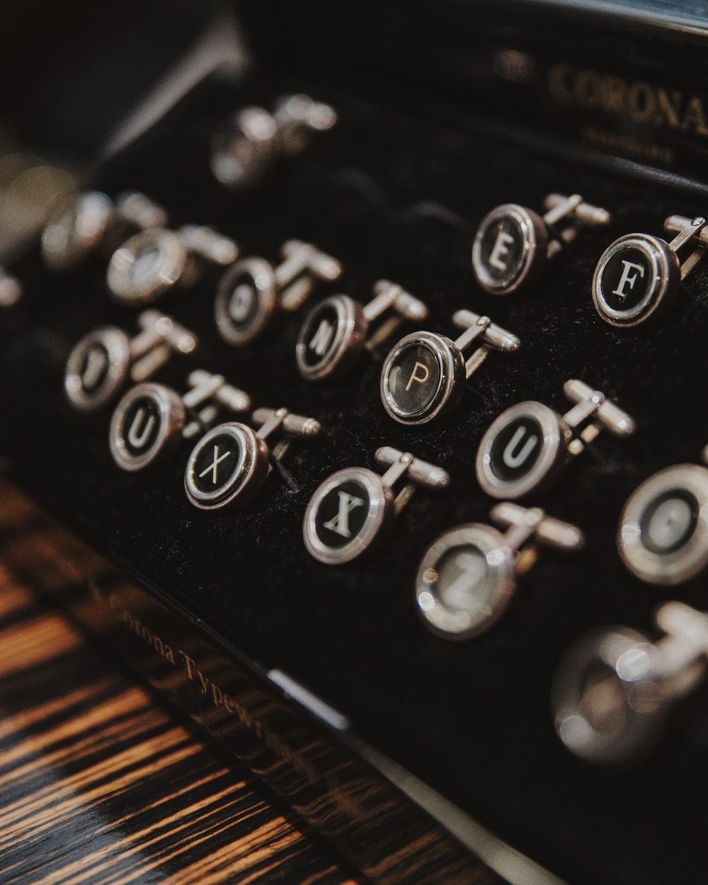 black and gray Corona typewriter