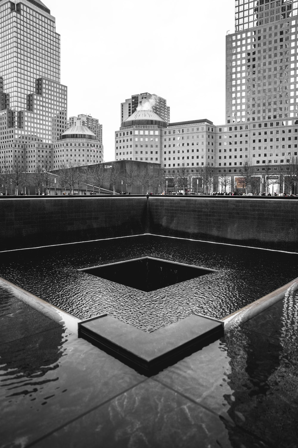 grayscale photography of empty fountain in the city