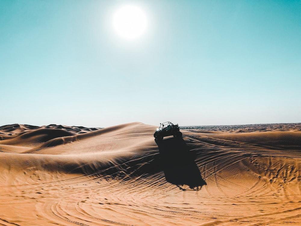 vehicle on desert during daytime
