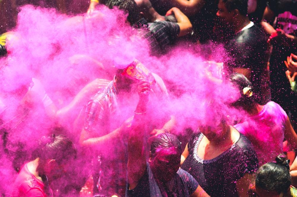 people using purple holi powder