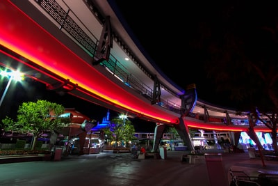 red neon lights lining the building tomorrowland teams background