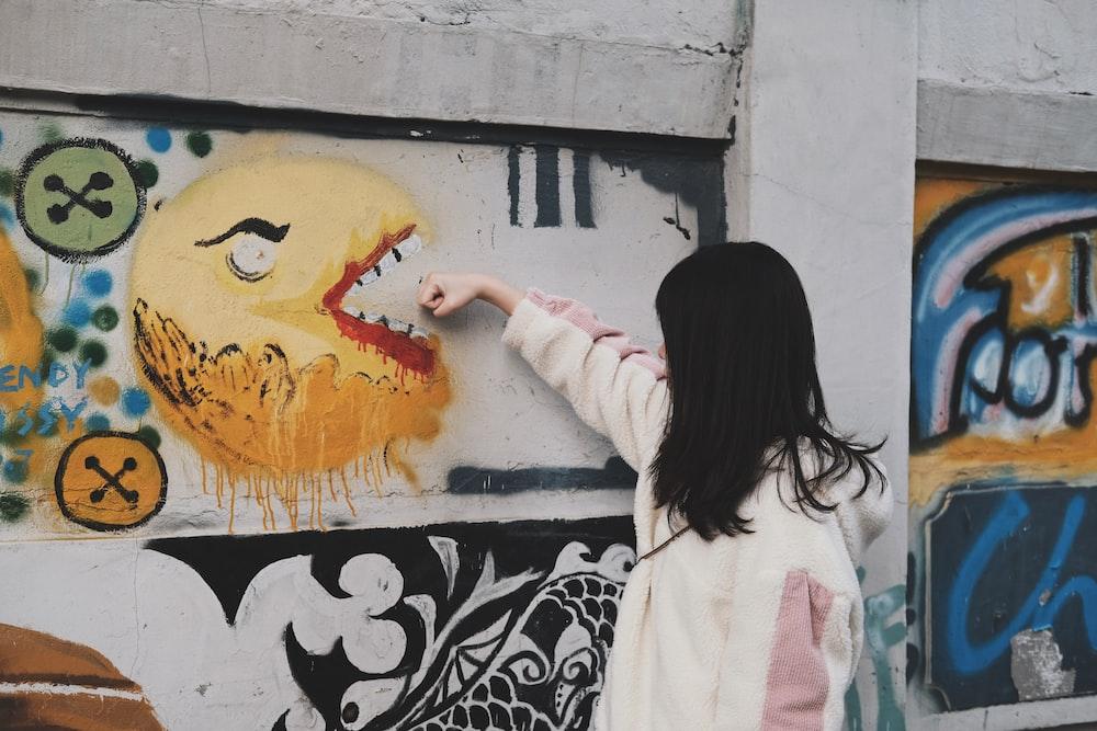 woman pointing emoji graffiti art