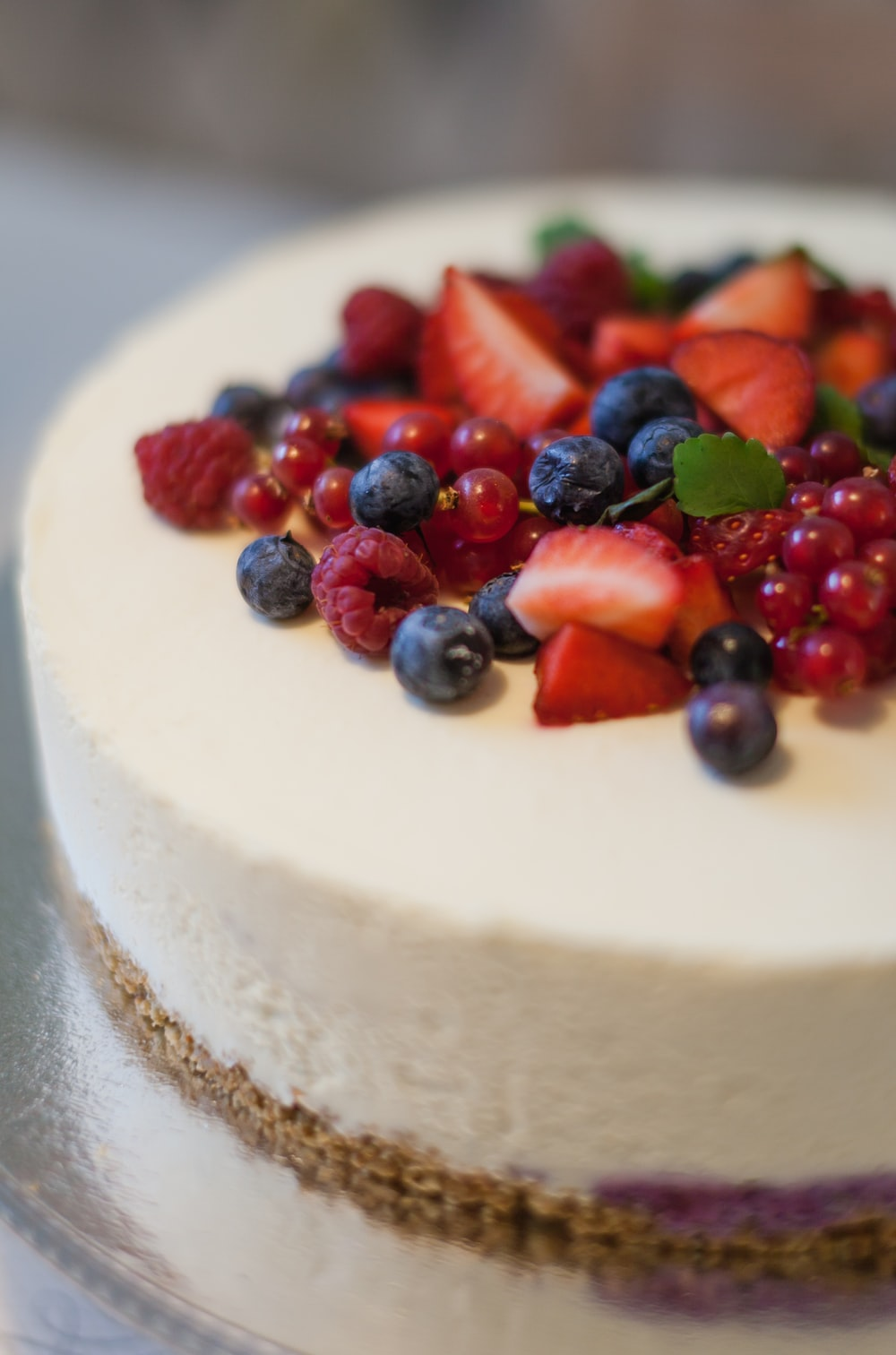 shallow focus photo of cake with sliced strawberries