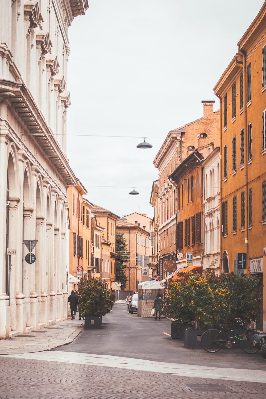 alley between brown and beige buildings