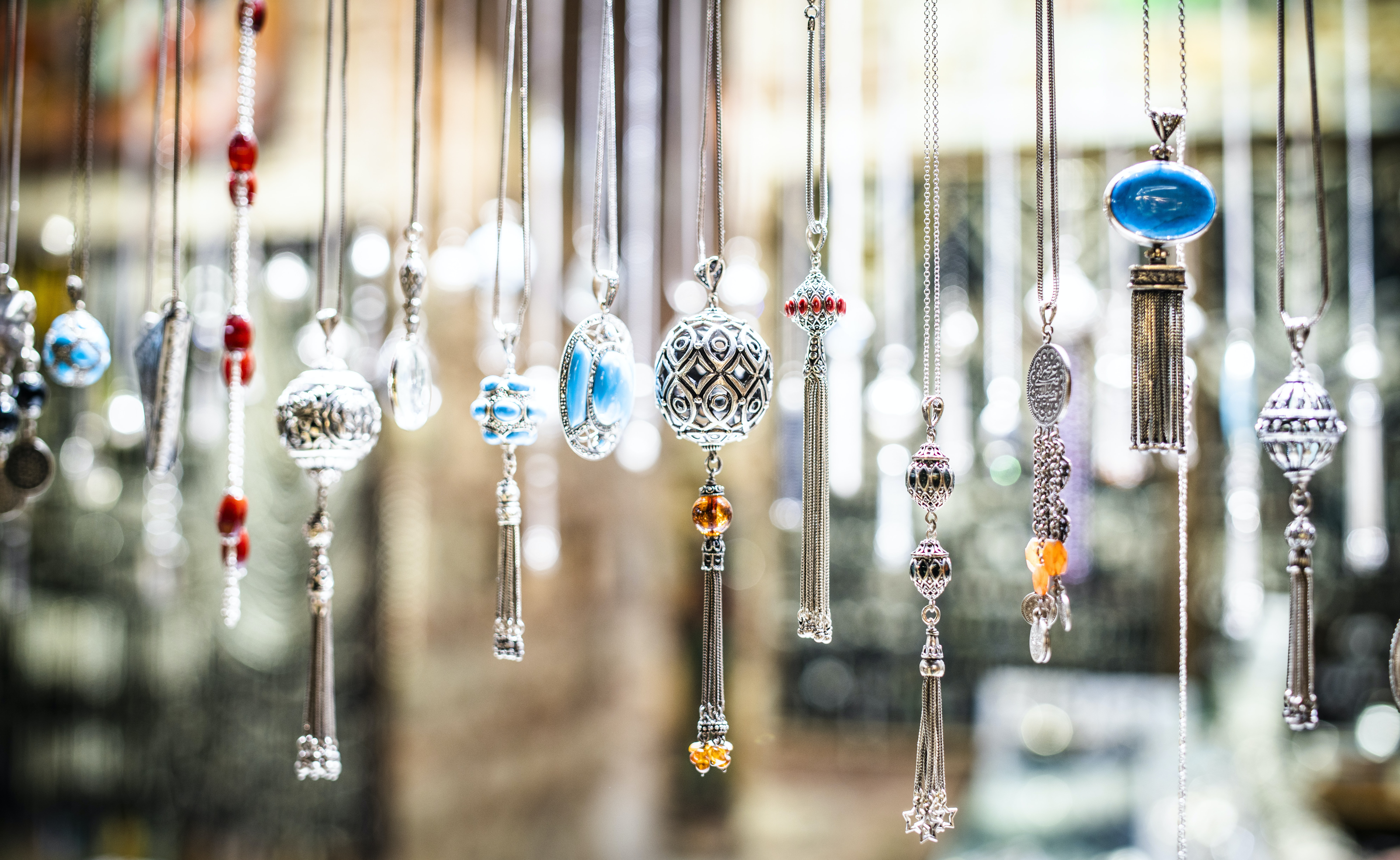 focus photography of assorted-color hanging decor lot