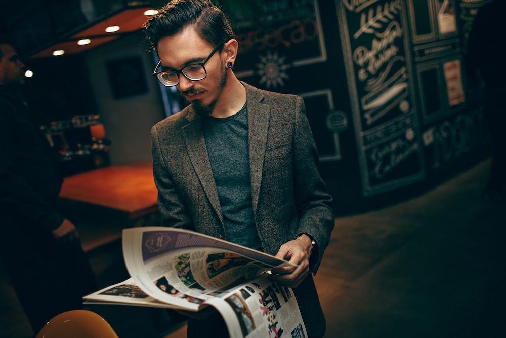 man holding magazine