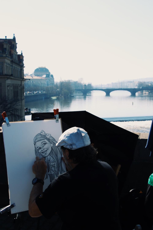 man doing sketch