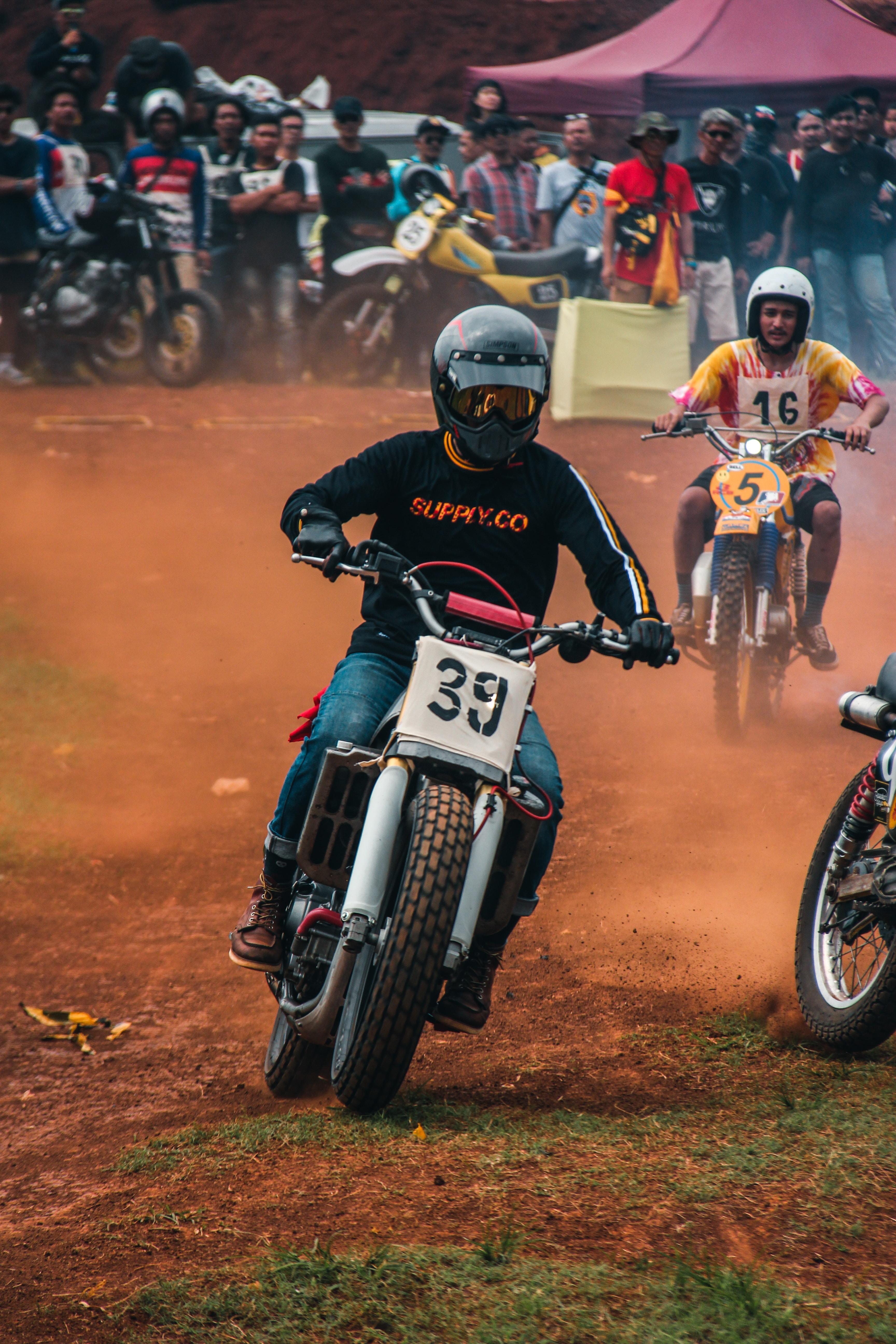 men dirt bike racing during daytime