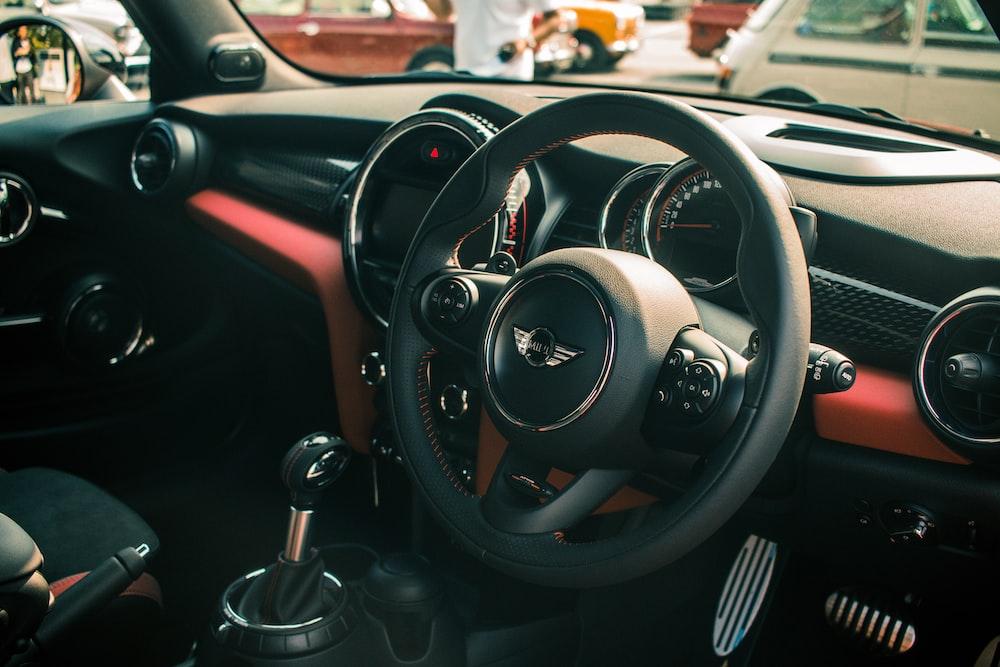 black Mini Cooper vehicle steering wheel in closeup shot