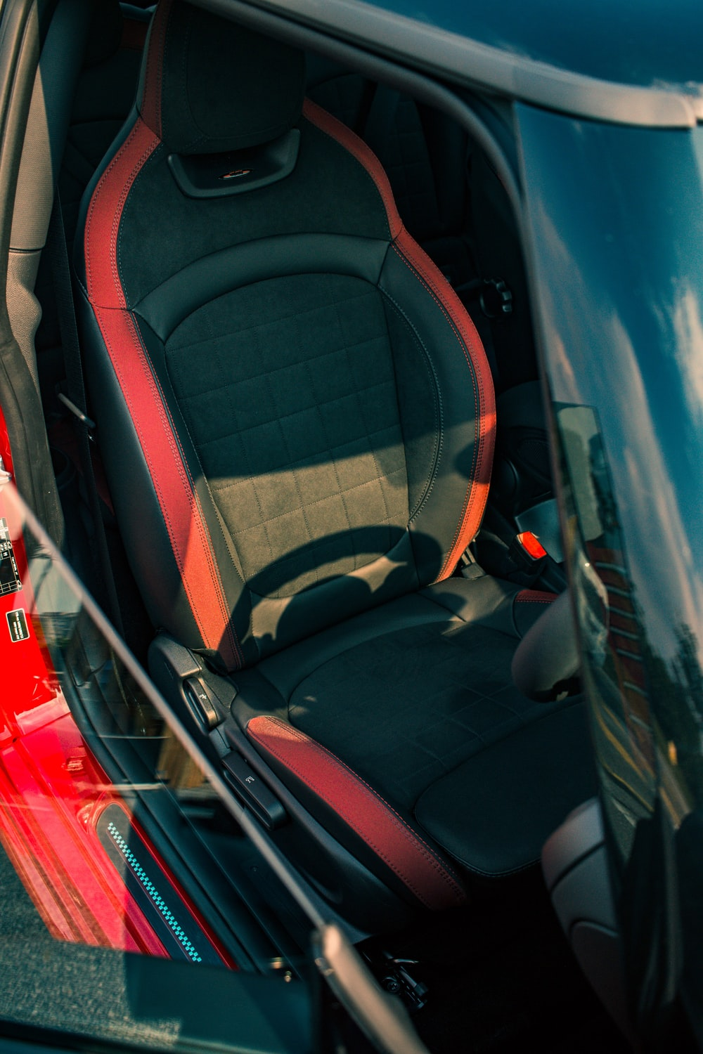 vacant black and red vehicle seat