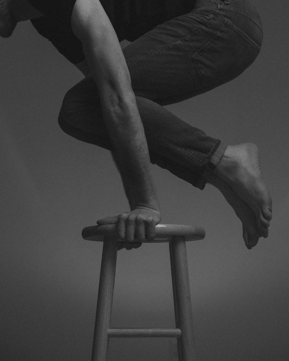 person raising body on chair