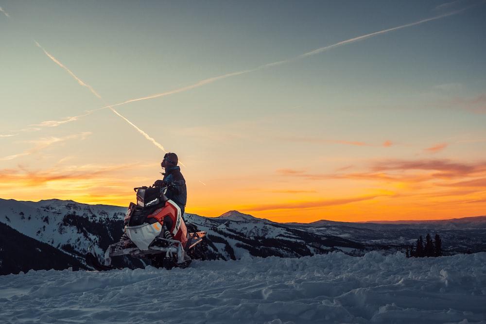 man riding snow mobile