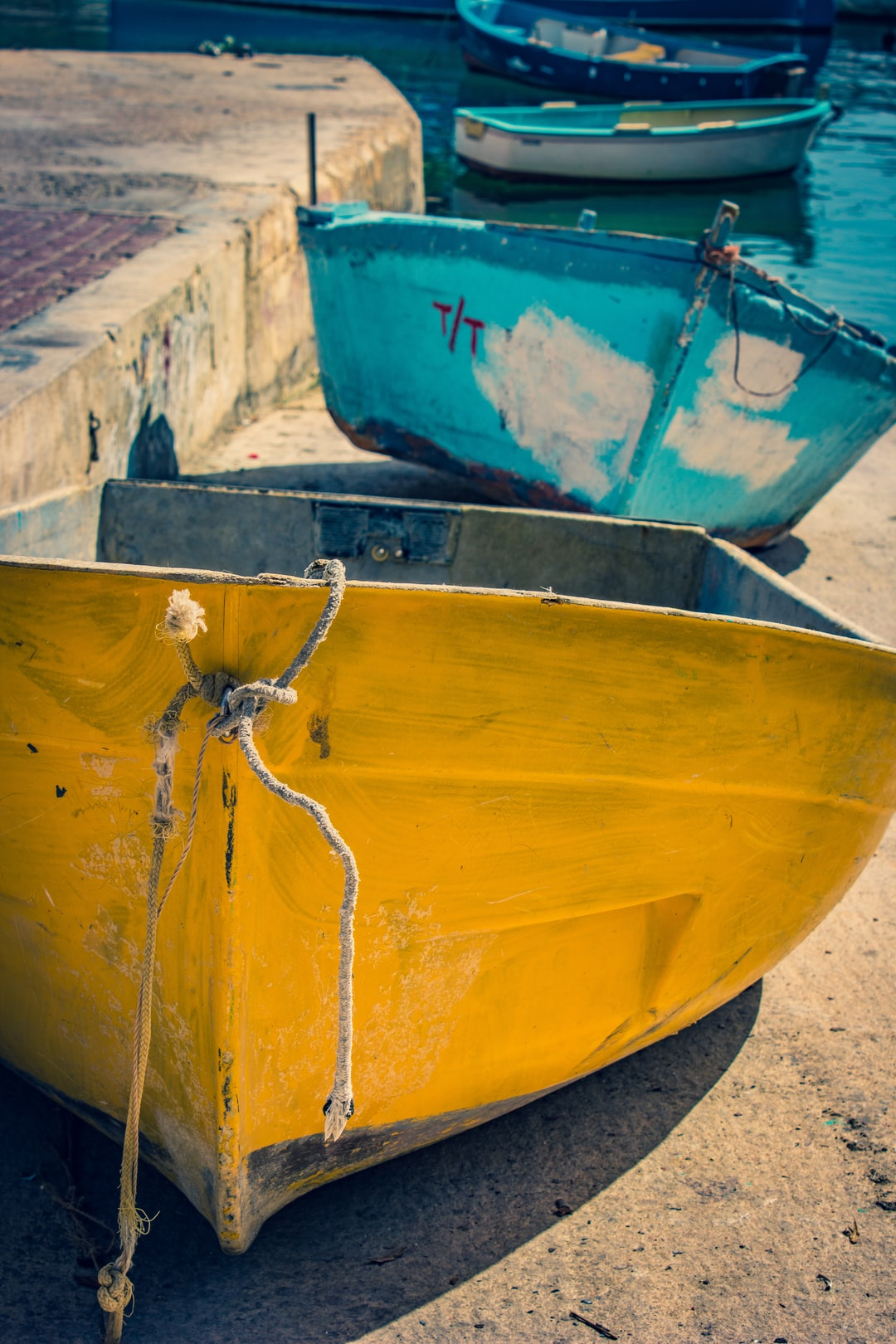 Simple little fishing boats that are hand painted and have a variety of colour applied