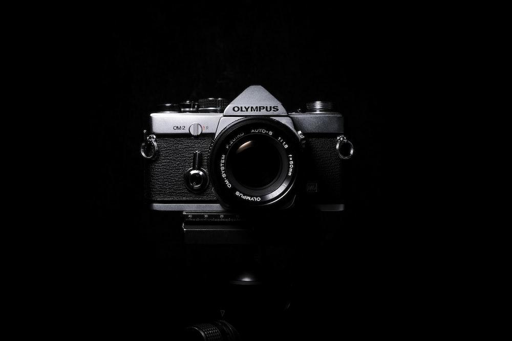 black and grey Olympus SLR film camera
