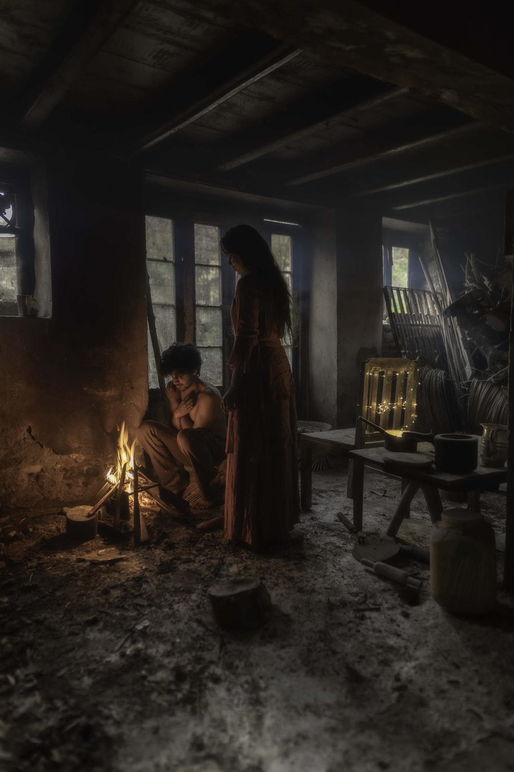 man and woman in front of bonfire inside room