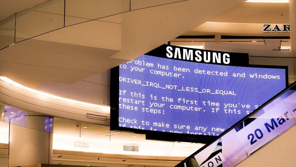 black Samsung flat screen monitor turned-on displaying boot sequence error