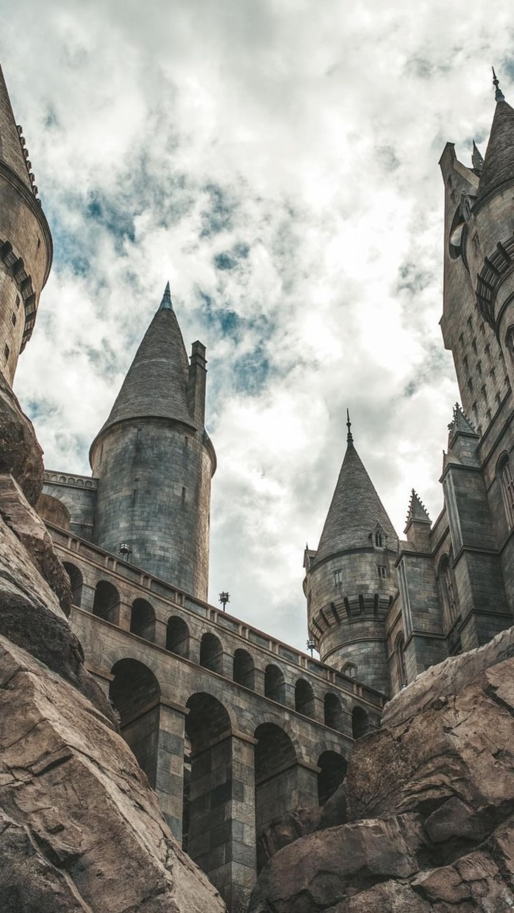 white clouds hovering above grey castle