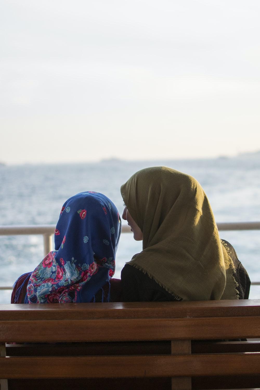 shallow focus photo woman wearing brown hijab headdress