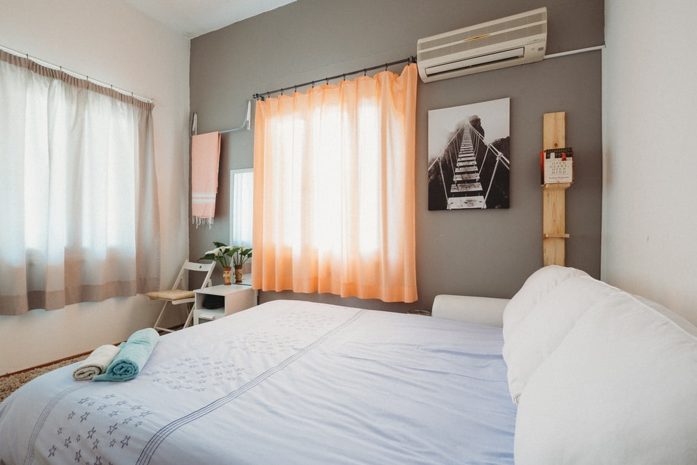 white bedspread inside room