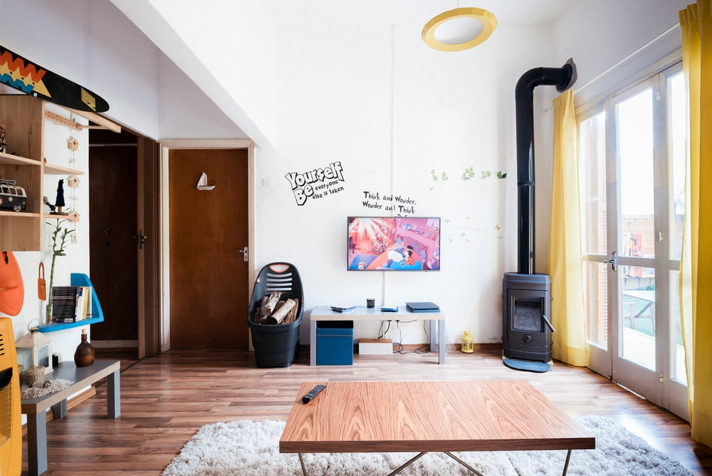 brown wooden coffee table near flat screen television