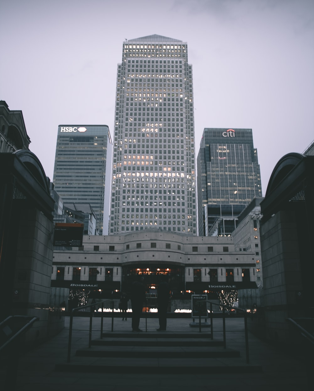 low angle photo of glass buildings