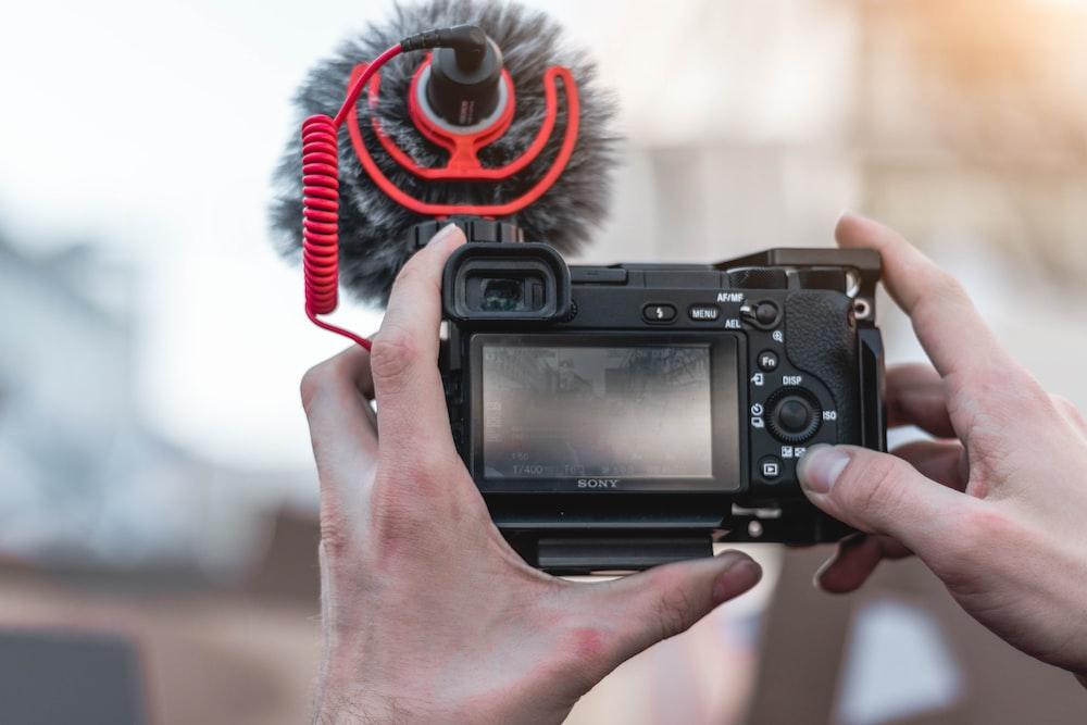 person holding vlogging camera