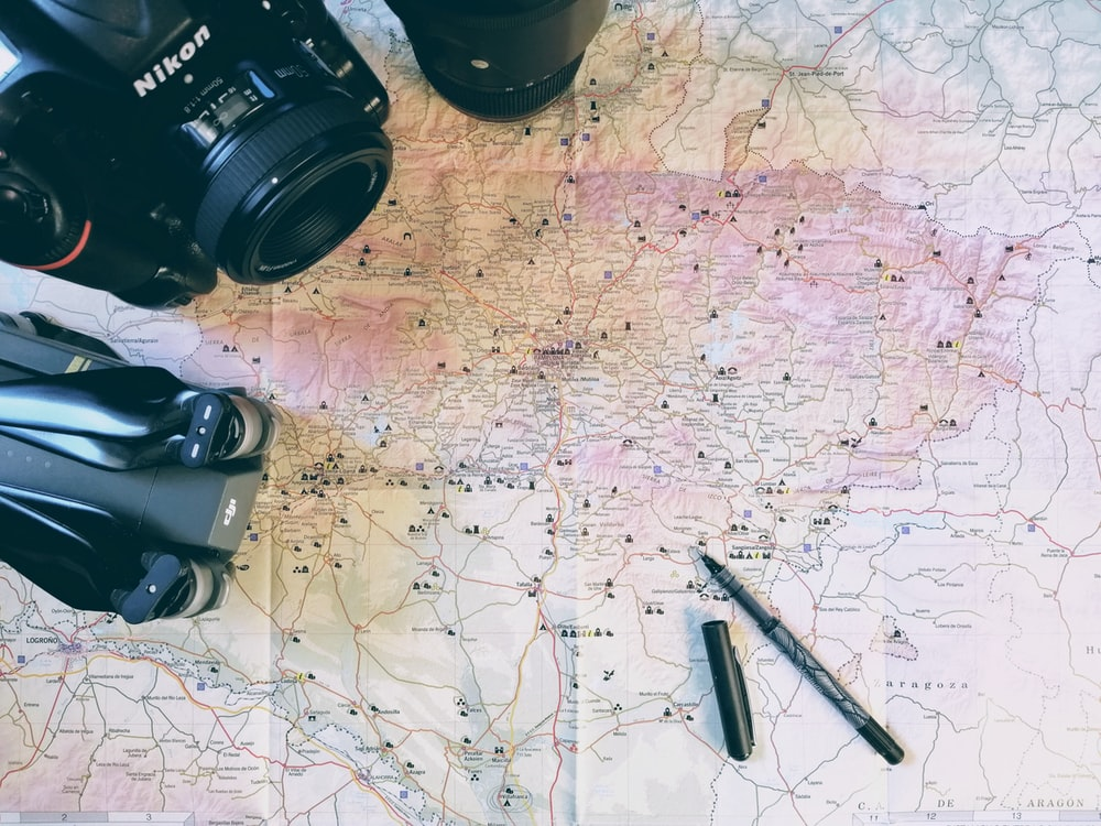 brown map and black Nikon camera